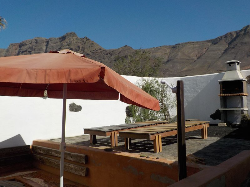 Terrace with outdoor shower, barbecue, hammock ...