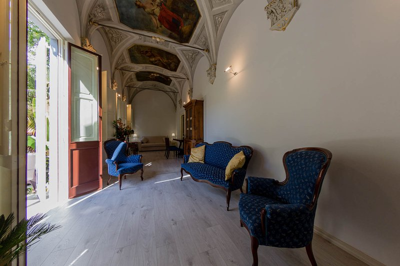 Breathe in Florence's glorious past as you climb the steps to this historic first-floor residence,