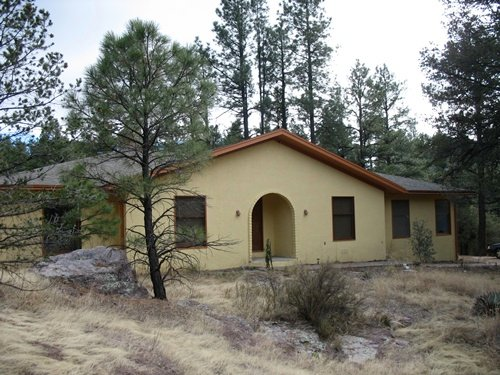 Raven House nestled in the pines  and rocks of Agave Spirit Retreat.