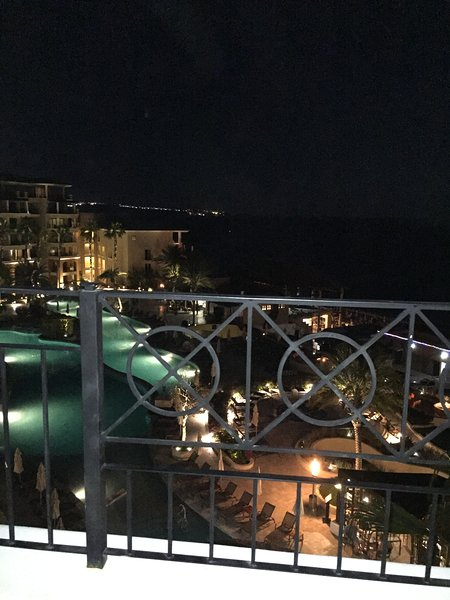 Night time view of the pool from the patio