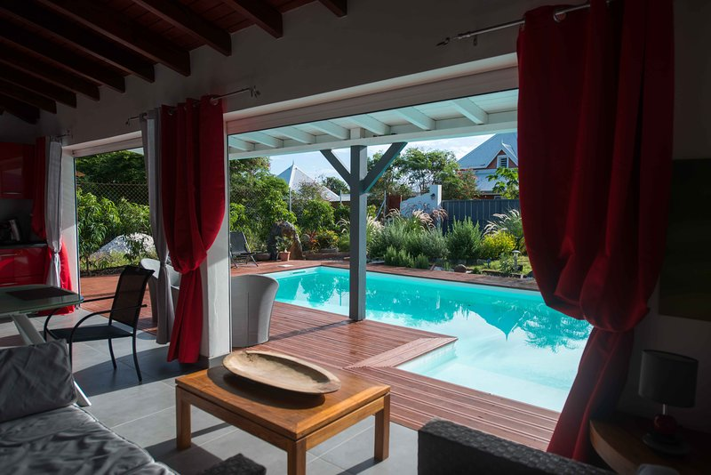 The living room overlooks the terrace and pool