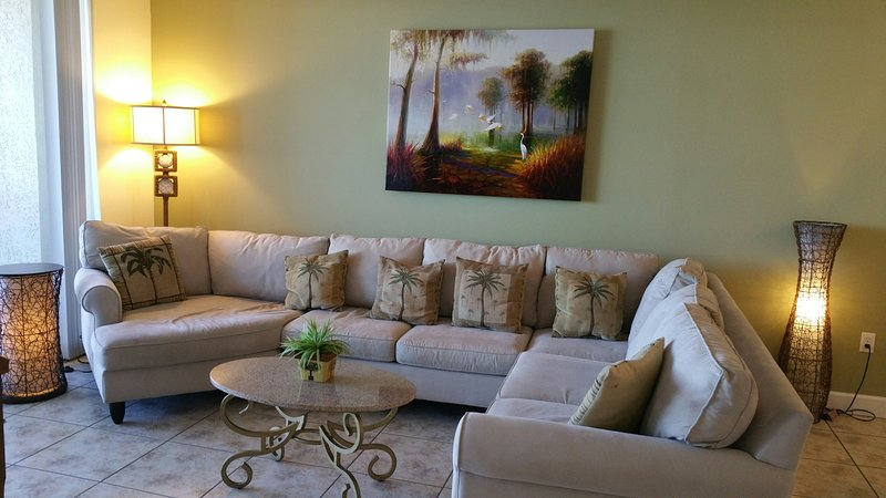 Comfy Sectional Sofa in Oceanfront Living Room w/ Fireplace