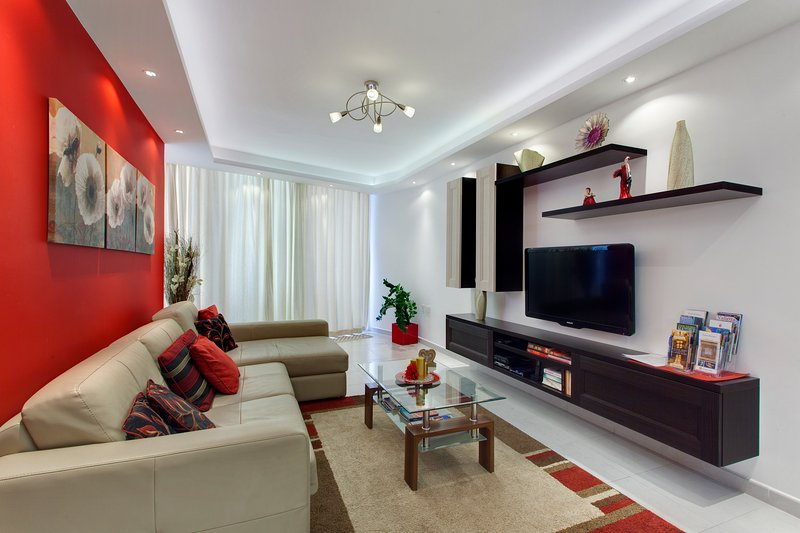 Living area with sofa bed and 2' LCD tv