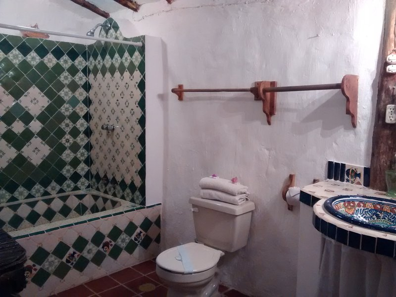 An authentic Mayan Hut converted into a room -  A private bathroom with Mexican arts and crafts -