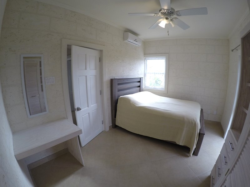 Air conditioned second bedroom with queen bed.