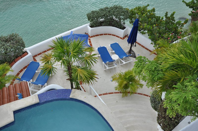Pool and main deck from upper studio balcony