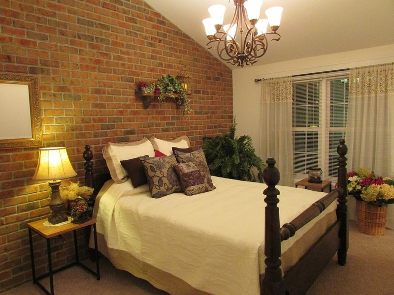 Master Bedroom,  High Cathedral  Ceilings with brick accent walls. Flat Screen HD TV