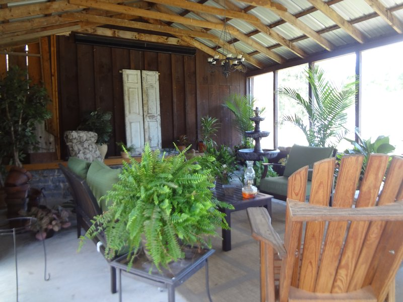 Screened in Pavilion, several water features and  plants perfect seating for visiting & Picnics