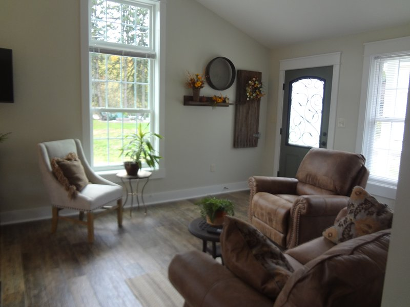 Living Area.  Tile Plank floors through most of house.  Home very clean and well kept.