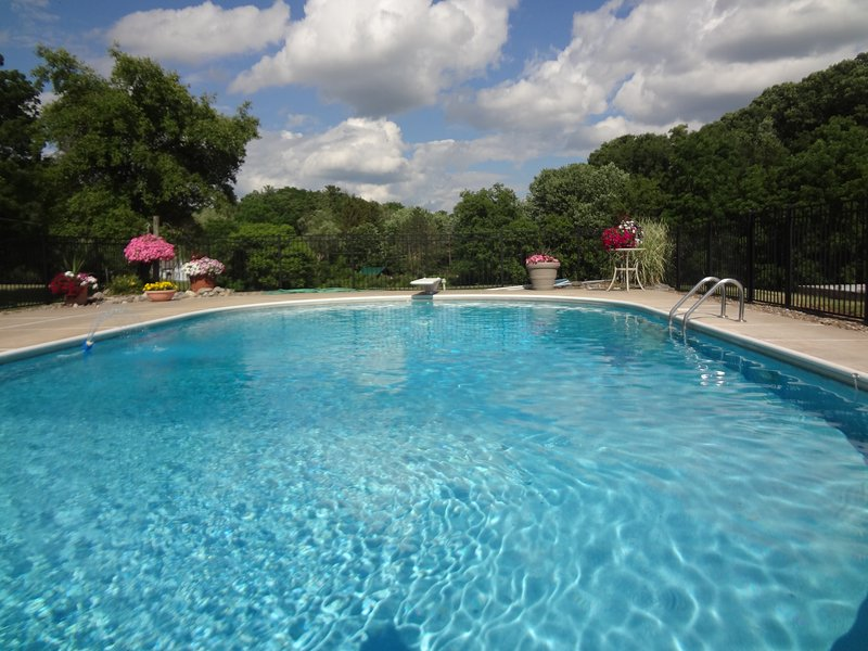 Large Private Heated Pool 9 ft.  in deep end 4 ft in shallow end.  Pool open from May through Sept