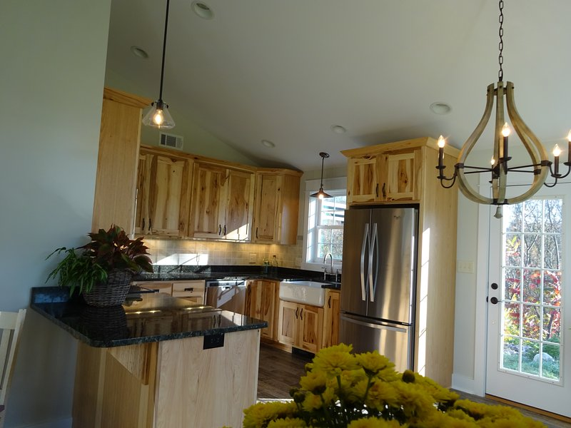 Kitchen area with deck off the back over looks Spring Creek
