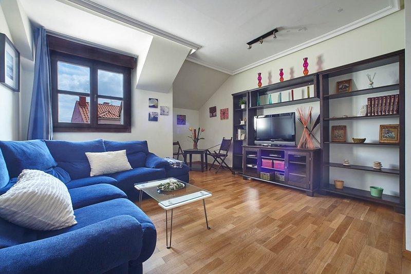 lounge com TV, DVD, livros e filmes