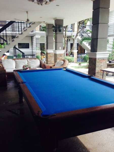 Pool table and Gas grill by pool and common areas