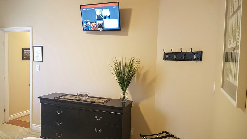 Both bedrooms have a 32' flat screen TV with Netflix, the dresser is located in bedroom 2.