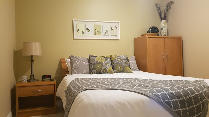 Bedroom 1 incorporates a queen size bed with night stand and armoir.