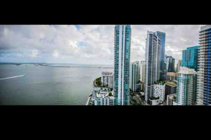 Full and direct view of Miami's skyline and open ocean from the balcony