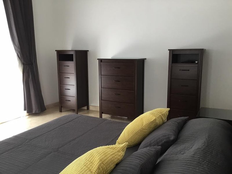 Large double ground floor bedroom with patio doors to outside and bathroom adjacent