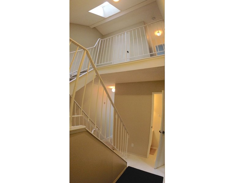 Bright and open front atrium with the skylight