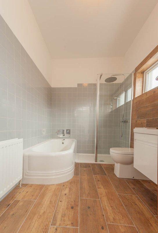 Amazing bathroom with fantastic original huge bath and walk in power shower.