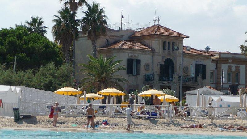 The villa, the bathing establishment, the public beach