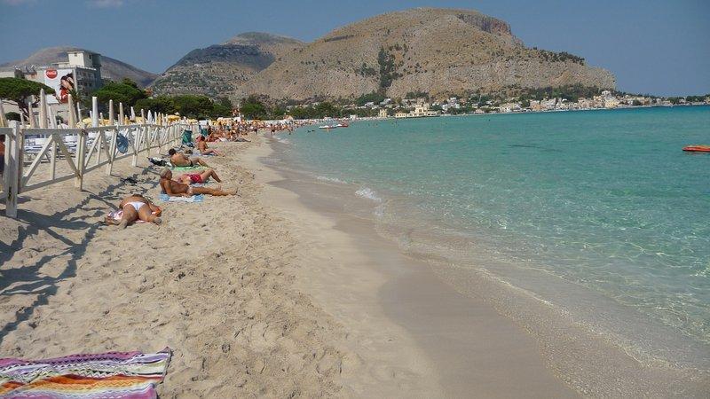 Public beach in front of the villa