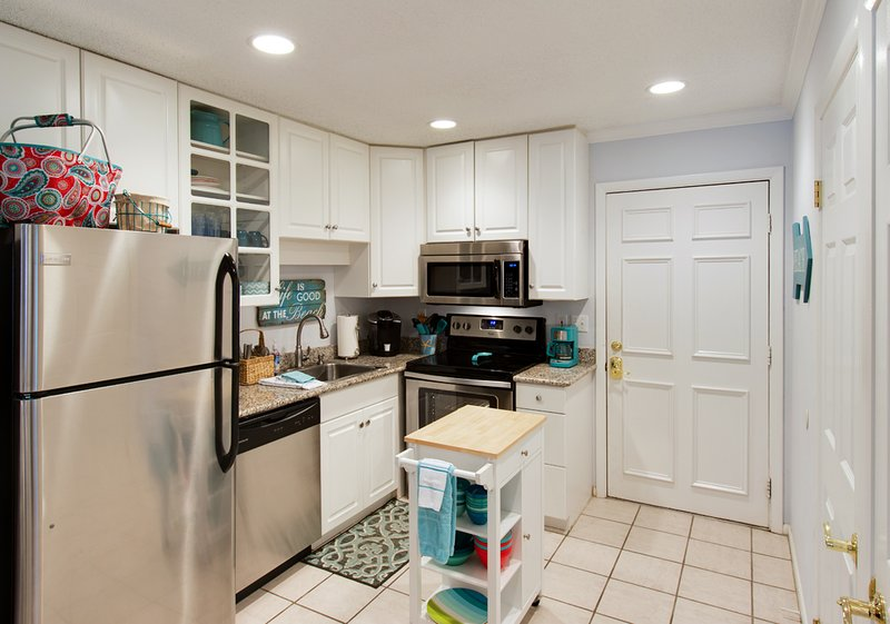 Kitchen area.  Granite and stainless steel appliances installed November 2015