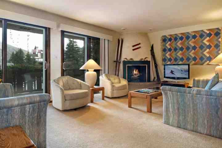 Spacious living room with 31' flat screen TV/DVD and wood burning fireplace.