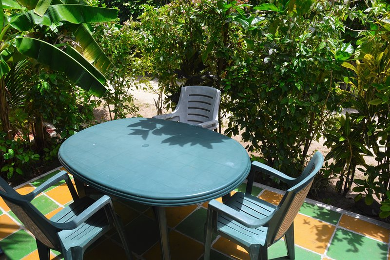 Table and chairs on front terrace