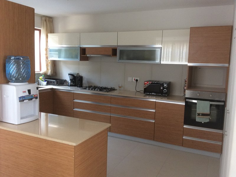 Modern Kitchen with all the amenities and cutlery you will need for a pleasant stay.