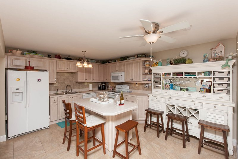 Full Gourmet Kitchen with dishwasher, icemaker micro and oven.