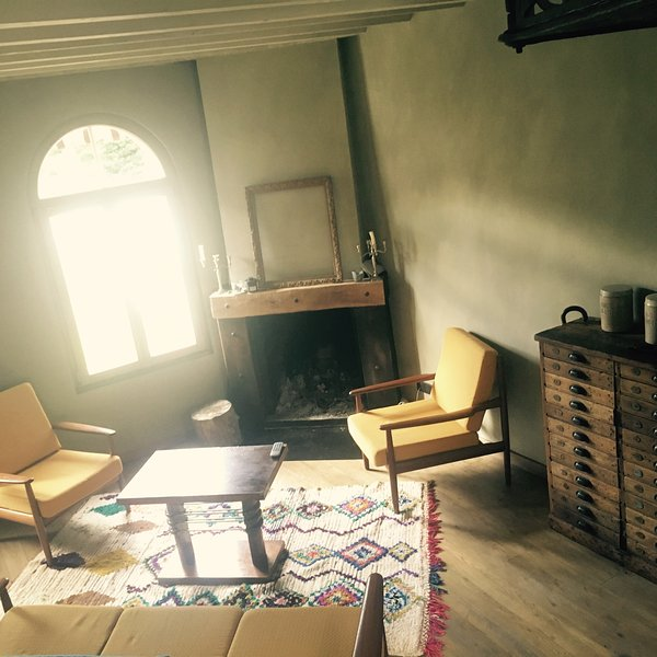 The living room and its fireplace