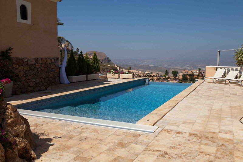 12m infinity pool with views over the village.