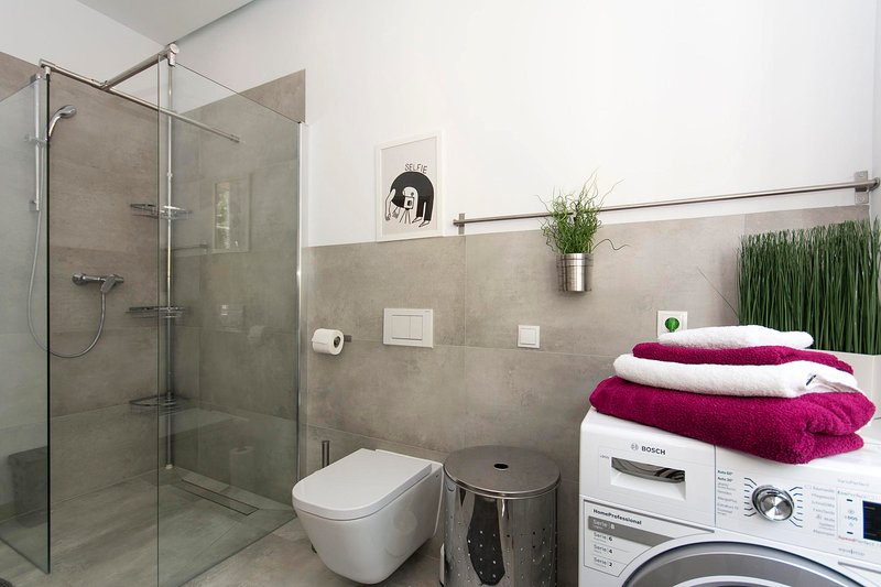 8m2 large bathroom with a window and a view of the cathedral.
