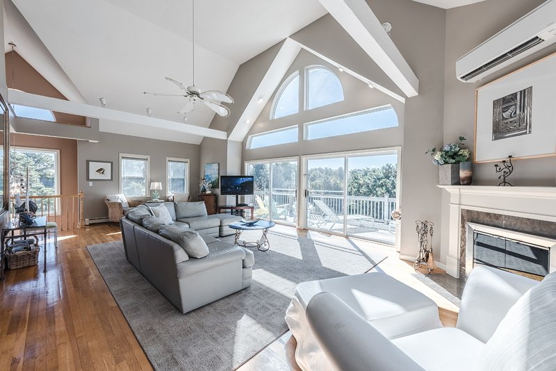 2nd Level Main Living Room with Vaulted Ceiling and Wall of Glass Sliders