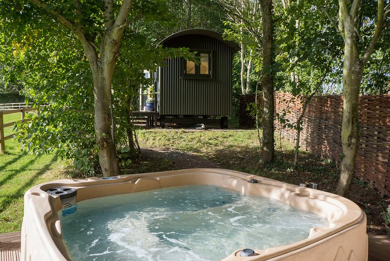 Private hot tub within a stones throw of the Luxury Shepherds Hut nestled amongst the woodland.