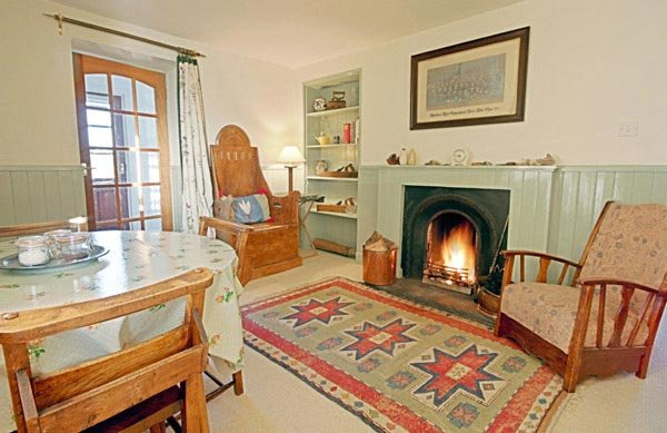 The homely warmth of an open fire in the kitchen