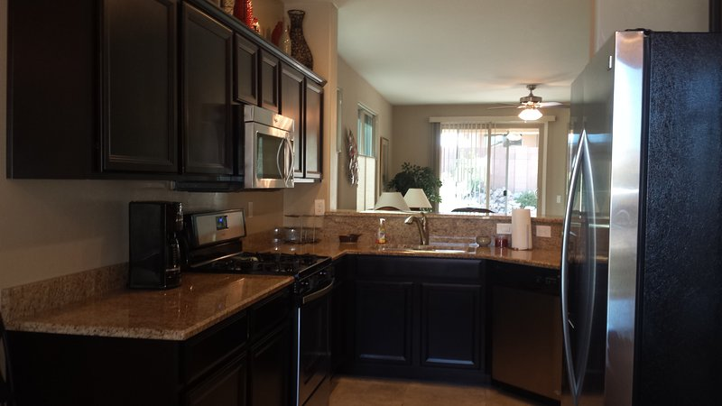 Kitchen with granite counters and stainless steel appliances