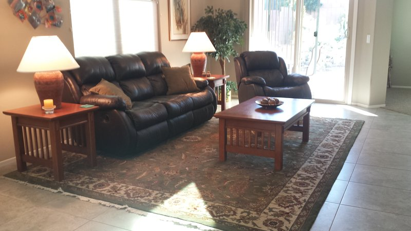 Living room with leather reclining coach and rocker recliner