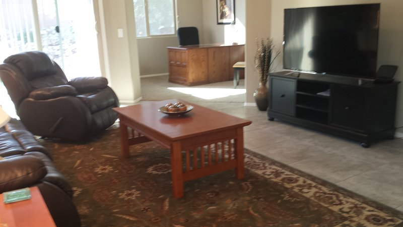 living room with 55 in TV with DVR