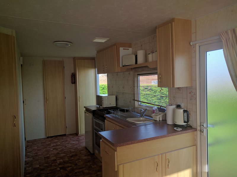 Kitcehn area. All appliances included. Door opens to a small secure veranda which is handy for pets.