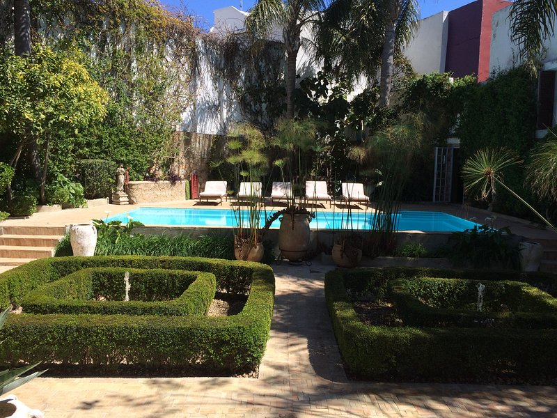 View of the garden and swimming pool ..