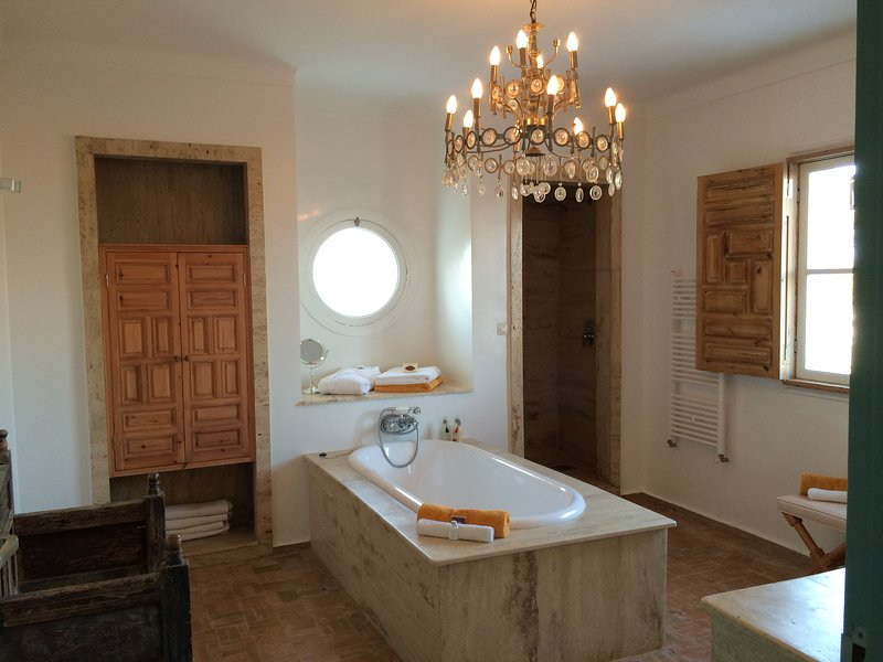 After spending a large dressing room, the Bathroom of Master Suite