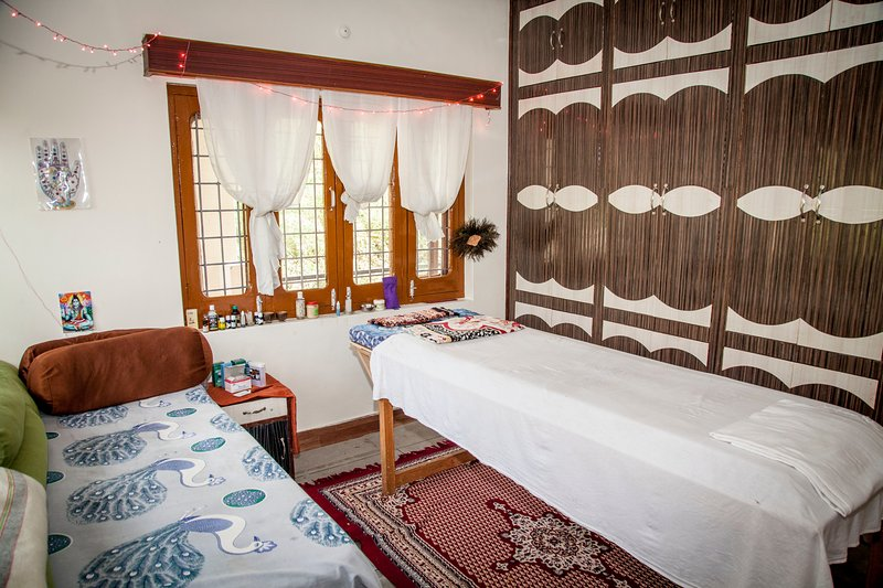 Healing room where we offer guests, travelers & locals for massage, reflexology & Reiki