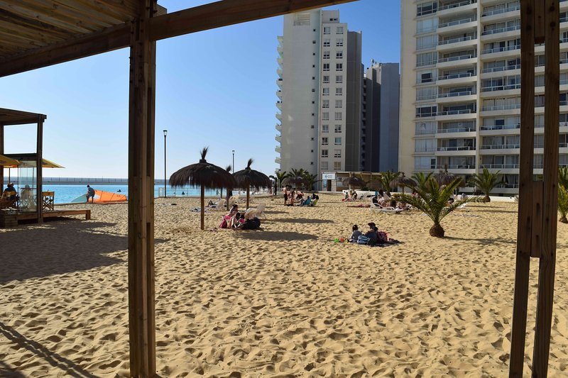 Beach umbrellas and chairs, which are commonly used for all visitors.
