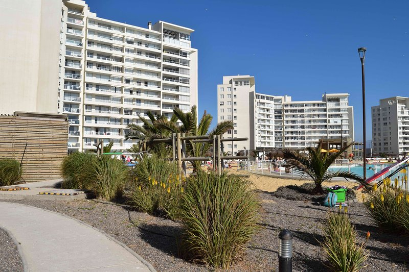 Pictured partial view of the beach and other buildings in the complex can be seen.