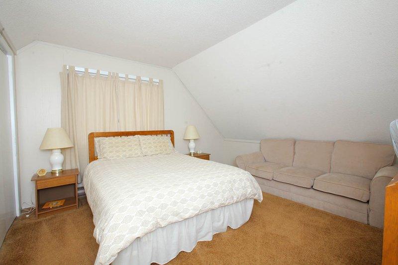 loft bedroom with queen bed