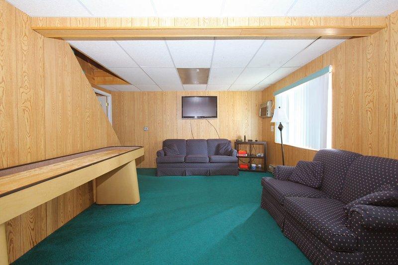basement with flat screen tv & shuffleboard