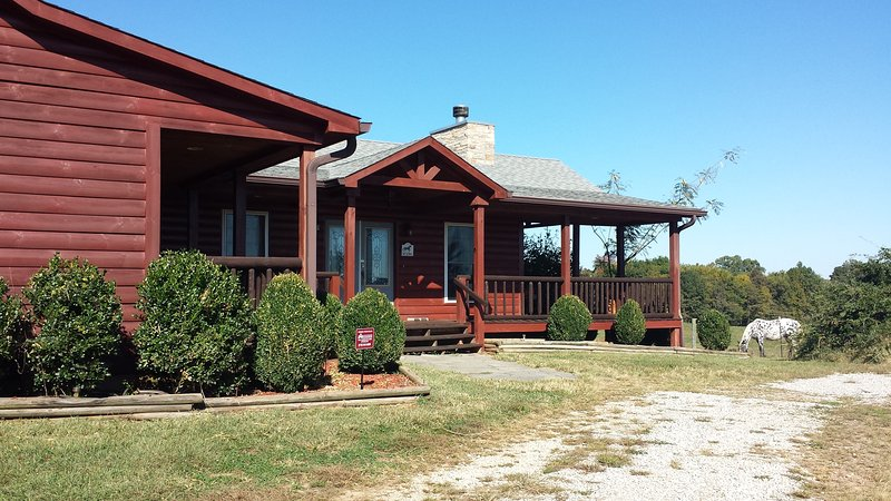 Beautiful Log house has covered decks to enjoy panoramic views of country side and horses grazing