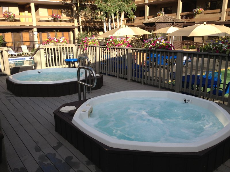 2 outdoor hot tubs - shown in the summer - but used more in the ski season