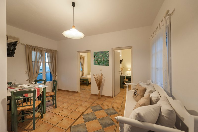 Family apartment's Kitchen- sitting room! T/V & A/C and access to a large sea view balcony!